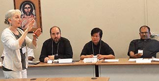 Peggy Kayne leads a session during the three week enculturation session held at Newman Theological College for priests from other countries who are serving in Western Canada.