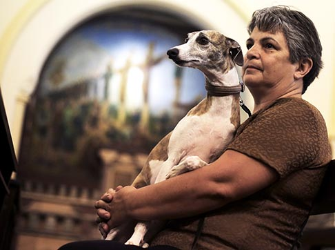 A dog sits on its owner's lap during a Mass for the blessing of the animals at St. Francis of Assisi Church in Sao Paulo, Brazil, Oct. 4. The blessing coincided with the feast of St. Francis of Assisi, patron saint of animals.