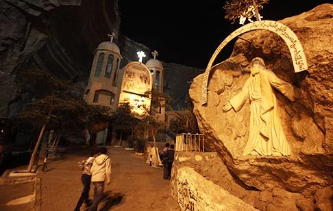 People enter the St. Simon monastery Oct. 9 to attend an event marking the second anniversary of the clashes in Cairo's Maspero Square, where 30 Christians were killed and more than 320 injured by security forces during a protest against discrimination.