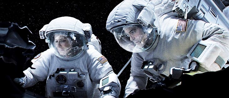 Sandra Bullock and George Clooney star in a scene from the movie Gravity.