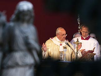 Pope Francis celebrates Mass at the Verano cemetery in Rome Nov. 1, the feast of All Saints.