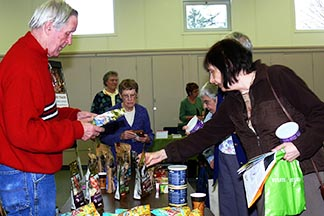 Val Merchant sells fair trade products at an event in the Catholic Pastoral and Administration Offices.
