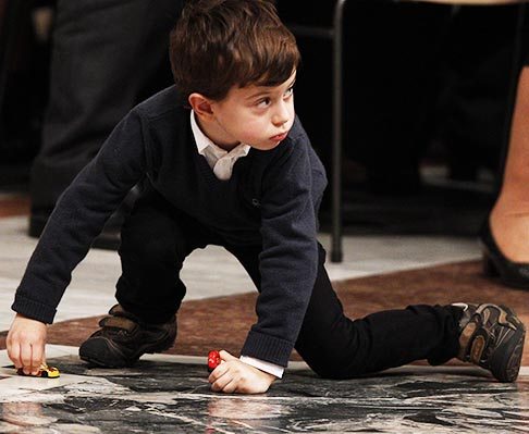 A boy plays with toy cars as Pope Francis celebrates the episcopal ordination of Bishop Fernando Vergez in St. Peter's Basilica Nov. 15.