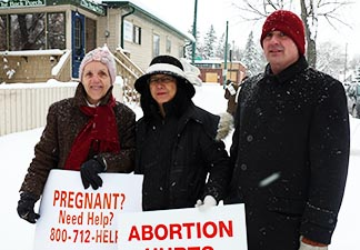 Joining pro-life champion Linda Gibbons, left, in protest across the street from Woman's Health Options, were Patty Hwong and Marion Biollo.