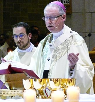 Archbishop Richard Smith, assisted by Deacon Kris Schmidt, celebrates the concluding Mass for the Year of Faith and the archdiocese's 100th anniversary Nov. 24 at St. Joseph's Basilica.