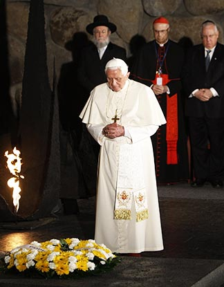 Pope Benedict XVI observes a moment of silence after laying a wreath in the Hall of Remembrance at Yad Vashem Holocaust memorial in Jerusalem May 11, 2009. During his trip to the Holy Land, the pope reaffirmed that the Catholic Church is committed to the path chosen at the Second Vatican Council for reconciliation between Christians and Jews.