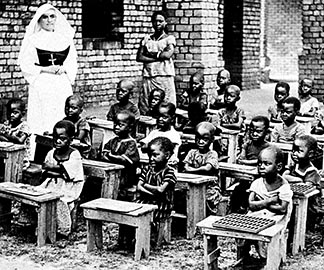 A nun teaches children in Africa in the image from the archives of the Congregation for the Evangelization of Peoples.