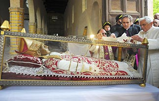 Pope Benedict XVI places a stole on the remains of St. Celestine V, a 13th-century pope, during his 2009 visit to the Basili8ca of Santa Maria di Collemaggio in L'Aquila, Italy. St. Celestine was the last pope to voluntarily resign before Pope Benedict stepped down in 2013.