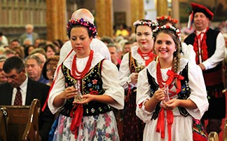 Members of the Polish Women's Alliance of America's Zamek Dancers carry the gifts to the altar during Mass at the historic St. Albertus Church in Detroit Aug 10. The Mass drew more than 2,000 people and was organized as part of a