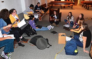 Students attending the recent National Catholic Student Leadership Conference take a musical break from their discussion.