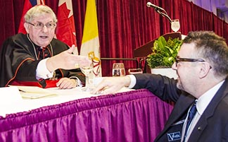 Cardinal Thomas Collins greets an attendee at the annual Cardinal's Dinner in Toronto.