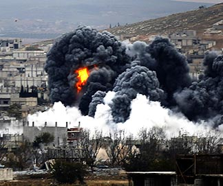 An explosion following a Nov. 17 airstrike is seen in central Kobani, Syria