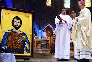 Archbishop Richard Smith blesses the jubilee icon of St. Joseph the Worker in May 2013.