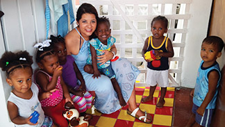 Scarboro missioner Paulina Gallego works with young children in a daycare centre in Guyana.