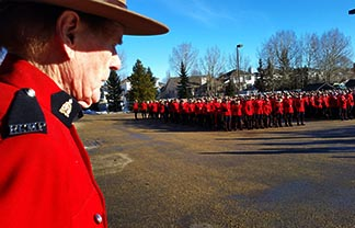 Patrick Ryan, a retired RCMP officer, observes the Mounties in the parking lot of Holy Family Church in St. Albert Jan 26 prior to the funeral of Const. David Wynn.
