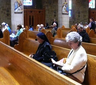 People came early on the Day of Confessions to celebrate the sacrament of Reconciliation at St. Joseph's Basilica.