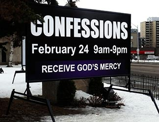 A sign on Jasper Avenue drew in passersby to be reconciled with the Lord.