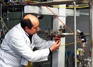 An International Atomic Energy Agency inspector checks the uranium enrichment process inside Iran's Natanz plant in January 2014.