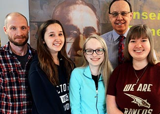 School chaplain Thomas Collins, students Monika Dyjak and Nicole Majdecki, principal Simon Pryma and student Dasa Belov draw inspiration from Archbishop Oscar Romero who will be beatified May 23.