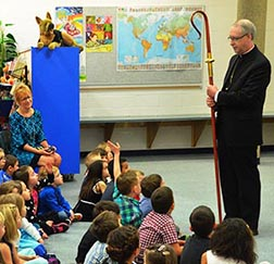 The archbishop fields a student question about his crozier.
