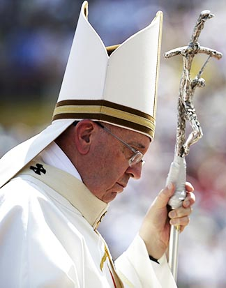 Pope Francis carries his crosier held together with a splint and tape as he arrives in procession to celebrate mass at Kosevo stadium in Sarajevo, Bosnia-Herzegovina, June 6.