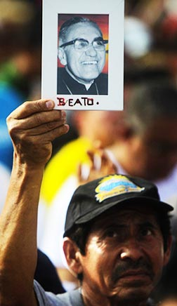A pilgrim holds a portrait of Archbishop Oscar Romero during the beatification Mass in San Salvador May 23.