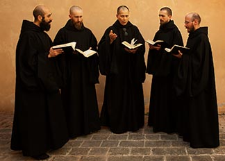Benedictine monks perform chants at the monastery of St. Benedict of Norcia, Italy