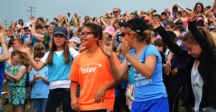 Six thousand students break into a spontaneous flash dance during a Mass on the Hill celebrating the 150th anniversary of Catholic education in St. Albert.
