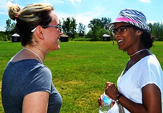 Theresa Robinson and Kamala Randhawa catch up every year at the Family Life Conference.