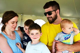 Matt LeBlanc (right) is following in his father's footsteps in helping lead the Catholic Family Life Conference. He is shown here with his wife Ammanda and 3 of their 5 children – Samuel, 3, Nate , 5, and Marcus, 8 months.