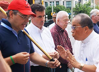 Fr. Bosco Wong asks John Pacheco and others intending to pray the rosary at Ottawa's Gay Pride Parade to do their praying inside St. Patrick's Basilica.