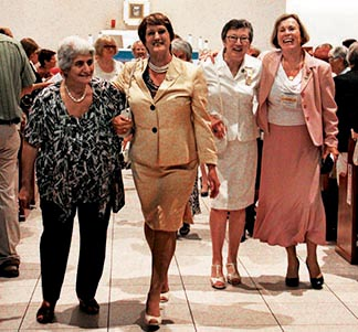 National CWL president Barbara Dowding (second from left) and others leave a Mass at the national CWL convention.