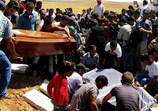 Relatives carry a coffin in Kobani, Syria, during the Sept. 4 funeral for two Syrian toddlers and their mother who drowned as they were trying to reach Greece