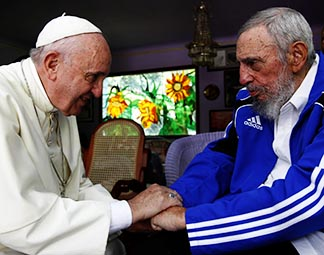Pope Francis and former Cuban President Fidel Castro hold hands at Castro's residence in Havana Sept. 20.