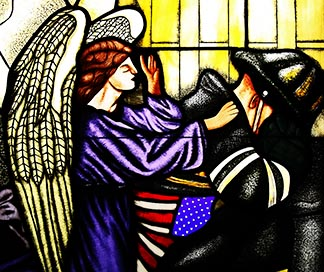 An angel comforting a firefighter is depicted in a stained-glass panel at St. Francis of Assisi Church in New York City.
