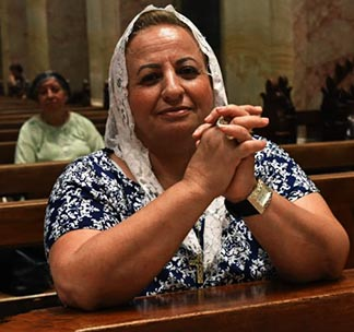 Margaret Injak, 63, a Catholic resident of Jerusalem's Old City, prays in St. Saviour's Parish.