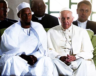 Pope Francis sits next to Imam Tidiani Moussa Naibi during a Nov. 30 meeting with the Muslim community at a mosque in Bangui, Central African Republic.