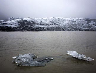 A view shows ice floating on a lake in front of the Solheimajokull Glacier in Iceland, where the ice has receded by more than one kilometre since annual measurements began in 1931.