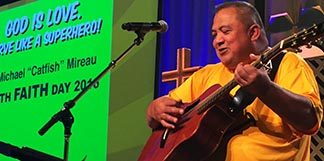 Jesse Manibusan sang songs and encouraged students to develop their talents at the Fr. Michael Mireau Youth Faith Day.