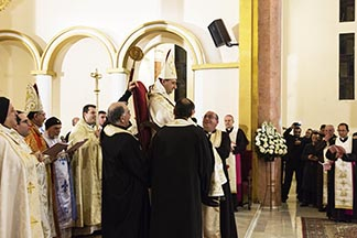 Syriac Catholic Bishop Antoine Nassif is carried on a chair during his Jan. 23 ordination Mass at Our Lady of Deliverance Cathedral in Beirut.