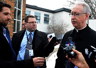 Archbishop Richard Smith meets with reporters Feb. 8 to discuss the meeting of the Alberta bishops with Education Minister David Eggen.