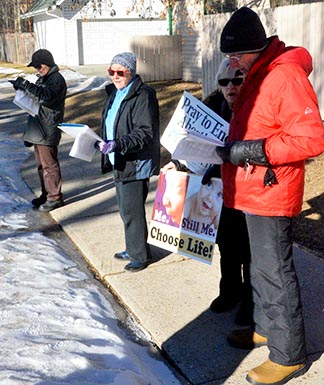 Pro-life prayer warriors stand across the street from Edmonton's abortion clinic.