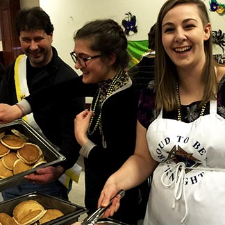 Abigail Hartman flips pancakes at a recent fundraiser at Assumption Church to support the 18 youth from Assumption and Resurrection parishes who will attend World Youth Day.