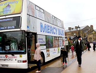 People walk by the Mercy Bus in Burnley, England, Feb. 20.