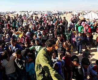 Syrian refugees wait at the border Jan. 13 near Royashed, Jordan.