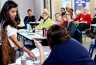 Sara Farid (left), CCODP's regional coordinator for in-Canada programs, leads a share Lent workshop in February 2014.