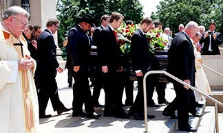 Pallbearers carry the casket of Gordie Howe from the Cathedral of the Most Blessed Sacrament in Detroit following a June 15 memorial Mass for the hockey great.