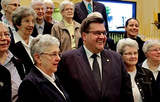 Montreal Mayor Denis Coderre poses for a photo with members of the Religious Hospitallers of St. Joseph, a community that has been in Montreal since the 17th century.