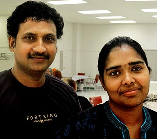 Shibu Anthony and his wife Nimmy Shibu thank Fr. Bob Kasun for the help he has given them.