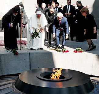 Pope Francis and Armenian President Serzh Sargsyan place flowers at the Tsitsernakaberd Memorial in Yerevan, Armenia, June 25. The monument honours those slain in the Armenian Genocide of 1915-1918.